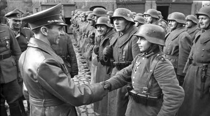 Joseph Goebbels congratulates the young Wehrmacht soldier