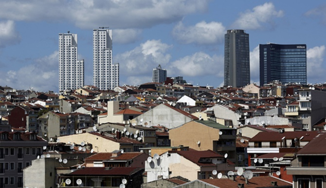 Skyscrapers are pictured behind old buildings in Beyoglu district in central Istanbul